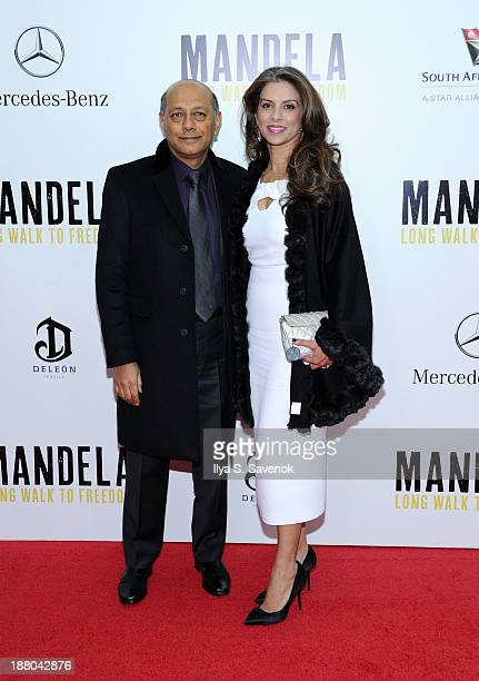 Producer Anant Singh and his wife Vanashree Singh attend the New York premiere of 'Mandela Long Walk To Freedom' hosted by The Weinstein Company...