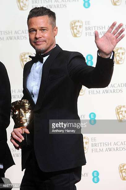 Producer and actor Brad Pitt winner of the Best Film award poses in the winners room at the EE British Academy Film Awards 2014 at The Royal Opera...