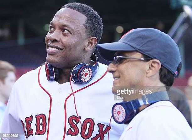 Producer and musician Dr Dre and Interscope and Geffen Records chairman Jimmy Iovine are on the field before the Boston Red Sox take on the the New...