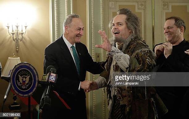 Producer and studio executive Harvey Weinstein and US Senator Charles E Schumer are joined by a broadway actor during the commemoration last week's...