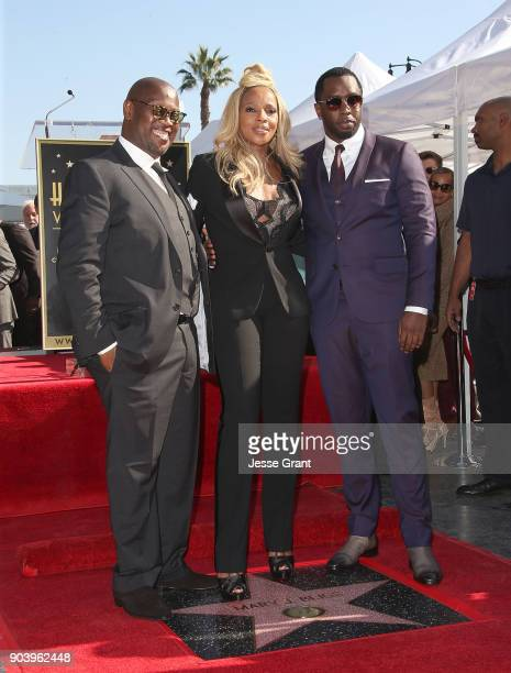 Producer Andre Harrell recording artist Mary J Blige and producer Sean 'Diddy' Combs attend the ceremony honoring Mary J Blige with a Star on The...