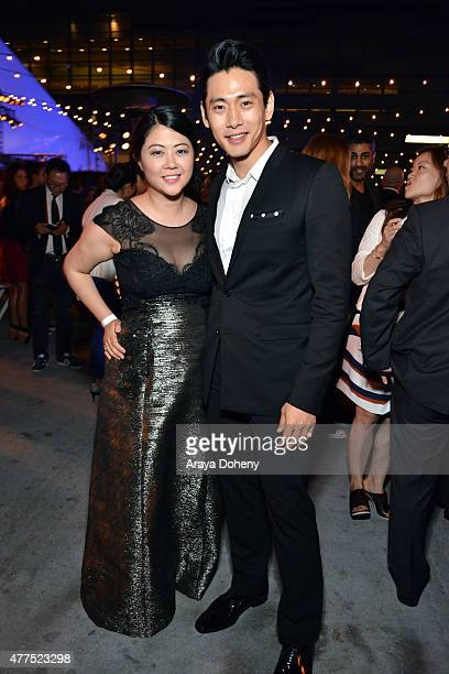 Producer Andrea Chung and actor Teo Yoo attend the Seoul Searching after party during the 2015 Los Angeles Film Festival at Festival Terrace on June...
