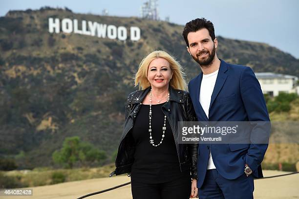 Producer Andrea Iervolino and Lady Monika Bacardi pose for a portrait session of AMBI Pictures at Hollywood Sign on February 21 2015 in Hollywood...