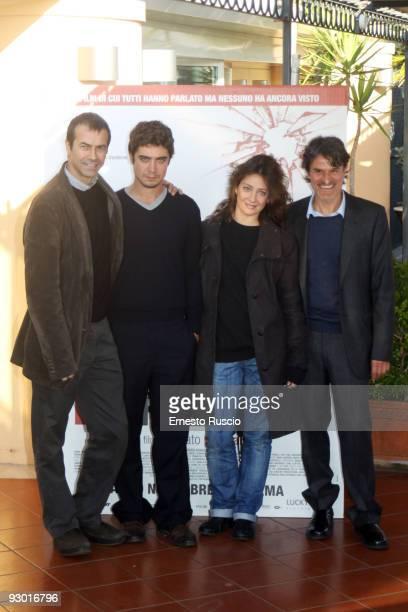 Producer Andrea Occhipinti actor Riccardo Scamarcio actress Giovanna Mezzogiorno and Director Renato De Maria attend the 'La Prima Linea' photocall...