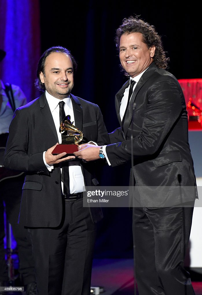 Producer Andres Castro (L) and singer/songwriter Carlos Vives accept the award for Best Tropical Song onstage during the 15th annual Latin GRAMMY Awards at the Hollywood Theatre at the MGM Grand Hotel/Casino on November 20, 2014 in Las Vegas, Nevada.