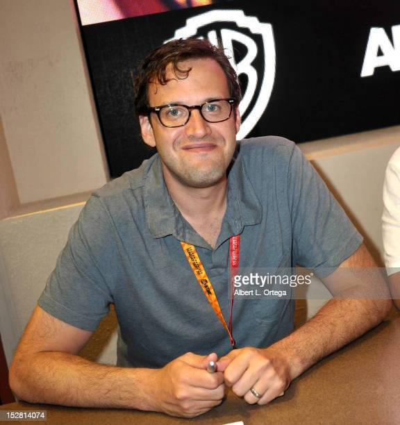 Producer Andrew Kreisberg signs autographs for 'Arrow' in the Warner Bros booth on Day 2 of ComicCon International 2012 held at San Diego Convention...
