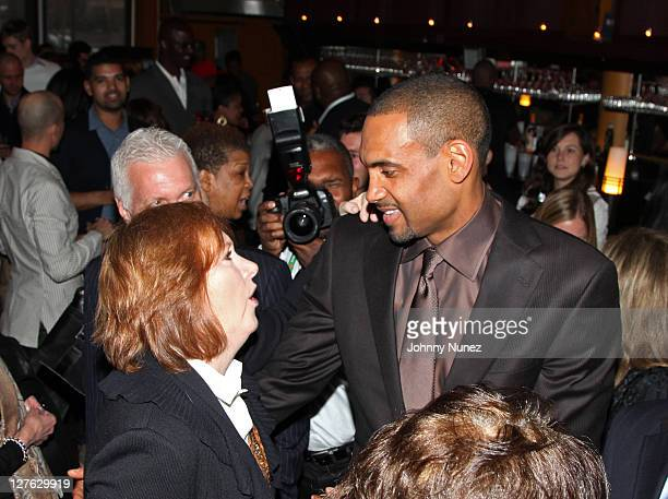 Producer Ann Rubenstein Tisch and Executive Producer and NBA Player Grant Hill attend the premiere of Starting at the Finish Line The Coach Buehler...