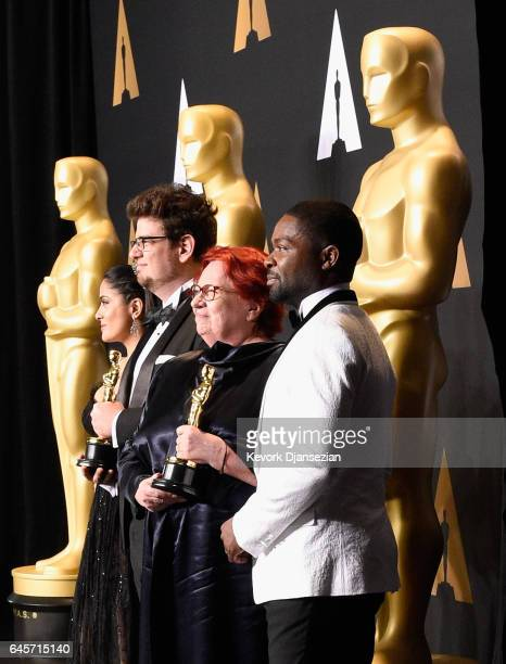 Producer Anna Udvardy and director Kristof Deak , winners of the award for Short Film for 'Sing,' pose with presenters Salma Hayek and David Oyelowo...