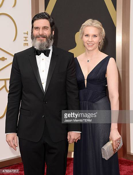 Producer Anthony Katagas and guest attend the Oscars held at Hollywood Highland Center on March 2 2014 in Hollywood California