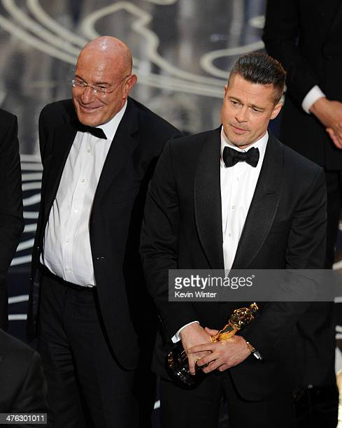 Producer Arnon Milchan and actor/producer Brad Pitt accept the Best Picture award for '12 Years a Slave' onstage during the Oscars at the Dolby...