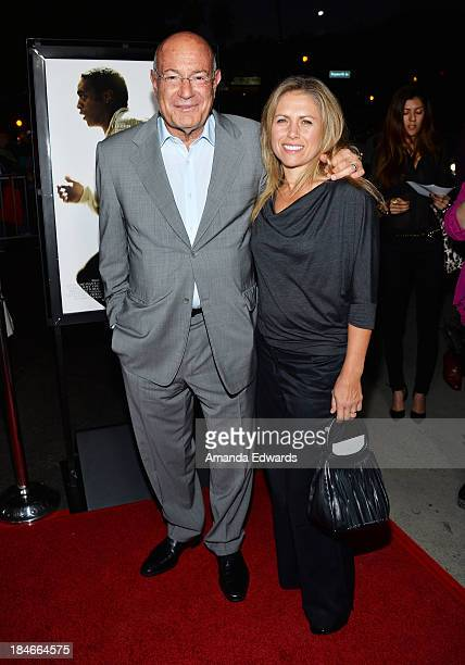 Producer Arnon Milchan and his wife Amanda Coetzer arrive at the Los Angeles premiere of '12 Years A Slave' at Directors Guild Of America on October...