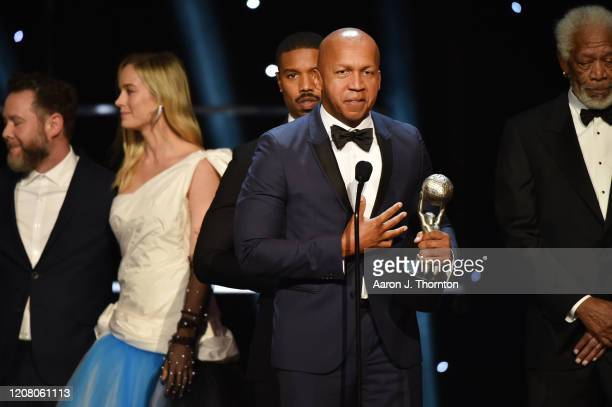 Producer Asher Goldstein Brie Larson Michael B Jordan and writer Bryan Stevenson accept the Outstanding Motion Picture award for Just Mercy onstage...