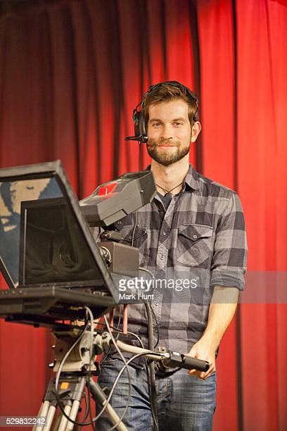tv producer at teleprompter in a tv studio - teleprompter stock pictures, royalty-free photos & images