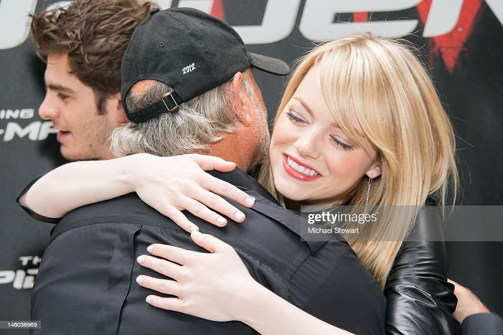 Producer Avi Arad (L) and actress Emma Stone attend the 'The Amazing Spider-Man' New York City Photo Call at Crosby Street Hotel on June 9, 2012 in New York City.