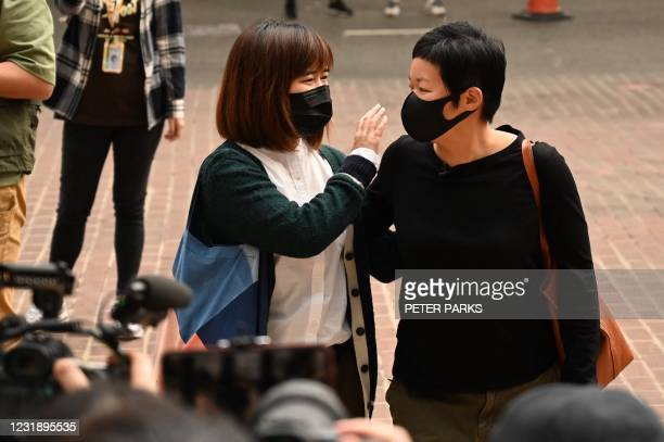 Producer Bao Choy arrives with her supporters to West Kowloon Magistrates Court, in Hong Kong on March 24, 2021 on charges related to her story which...