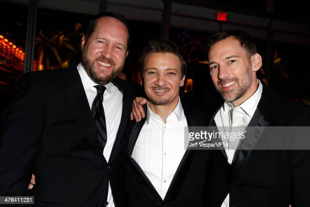 Producer Beau Flynn actor Jeremy Renner and talent agent Joel Lubin attend the 2014 Vanity Fair Oscar Party Hosted By Graydon Carter on March 2 2014...