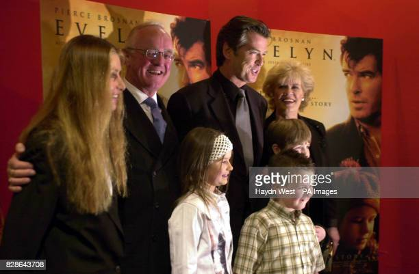 Producer Beau St Clair Father Ted's Frank Kelly Pierce Brosnan and inspiration for their new film Evelyn Doyle together with their younger costars...