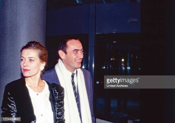 Producer Bernd Eichinger with actress Barbara Rudnik at the opening gala of Cinedom Cinema center at Cologne, Germany, 1991.
