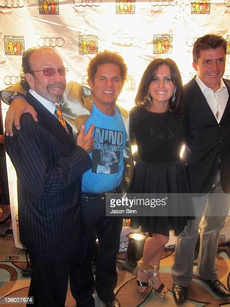 Producer Bernie Yuman Pop Artist Romero Britto Ellen Feldenkreis and Perry Ellis International COO President Oscar Feldenkreis pose during Miami...