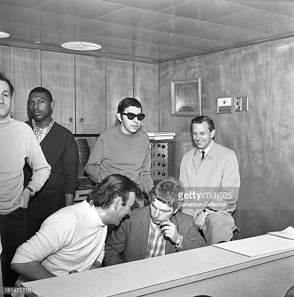 Producer Bert Berns Van Morrison and engineer Brooks Arthur in the booth recording Van Morrison's first record Blowing Your Mind at a Bang Records...