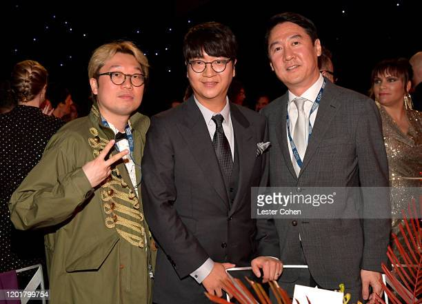 Producer Big Hit Entertainment Pdogg CEO of Big Hit Entertainment Lenzo Yoon and COO of Big Hit Entertainment Jinhyeong Lee attend MusiCares Person...