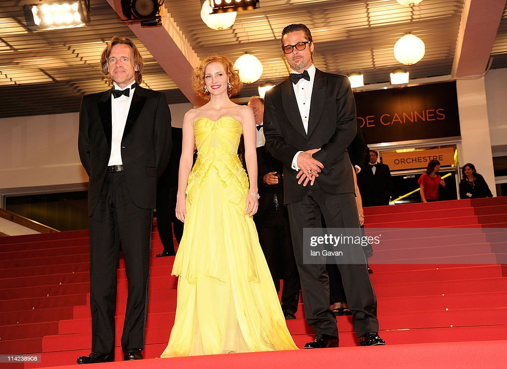Producer Bill Pohlad, actress Jessica Chastain and actor Brad Pitt depart 'The Tree Of Life' premiere during the 64th Annual Cannes Film Festival at Palais des Festivals on May 16, 2011 in Cannes, France.