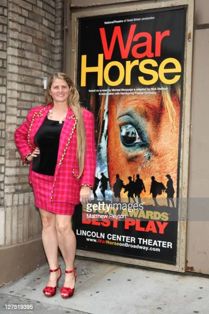 Producer Bonnie Comley poses with 'War Horse' poster during the League of Professional Theatre Women 30th Anniversary with Bonnie Comley Others at...
