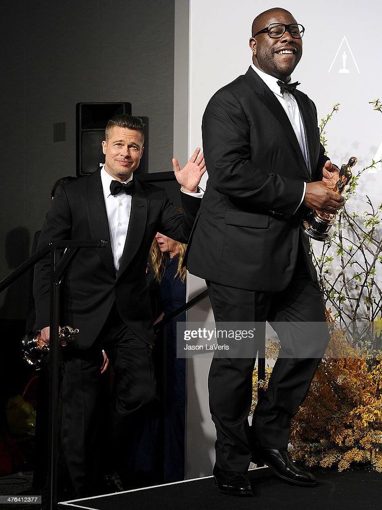 Producer Brad Pitt and director Steve McQueen, winners of Best Picture for '12 Years a Slave', pose in the press room at the 86th annual Academy Awards at Dolby Theatre on March 2, 2014 in Hollywood, California.