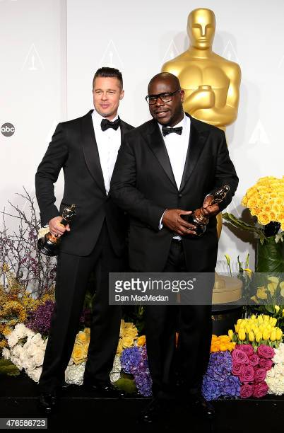 Producer Brad Pitt and director Steve McQueen, winners of Best Picture for '12 Years a Slave,' pose in the press room at the 86th Annual Academy...