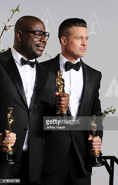 Producer Brad Pitt and director Steve McQueen winners of Best Picture for '12 Years a Slave' pose in the press room during the 86th Annual Academy...