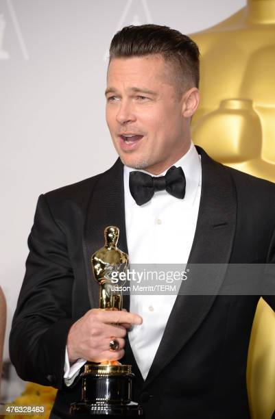 Producer Brad Pitt winner of Best Picture for 12 Years a Slave poses in the press room during the Oscars at Loews Hollywood Hotel on March 2 2014 in...