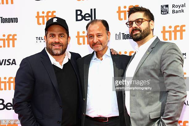 Producer Brett Ratner director Fisher Stevens and National Geographic Executive Tim Pastore attend the 'Before The Flood' premiere held at Princess...