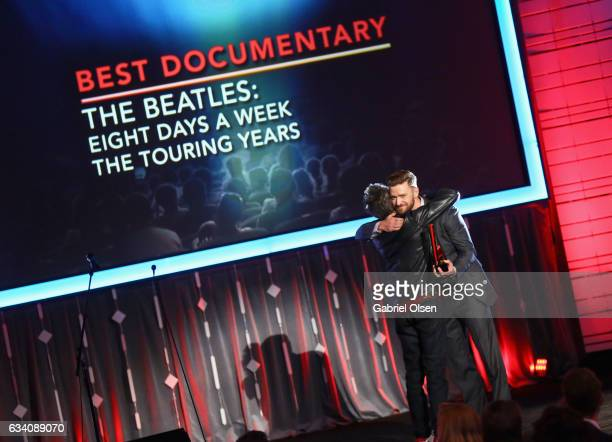 Producer Brian Grazer accepts the Best Documentary award for 'Beatles Eight Days A Week' from Presenter Justin Timberlake at the 16th Annual AARP The...