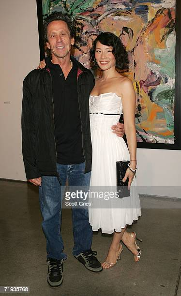 Producer Brian Grazer and actress Lucy Liu attend Lucy Liu's art exhibit and auction hosted by The The RitzCarlton Hotel Company to raise money for...