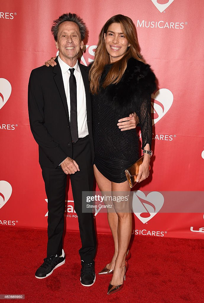 Producer Brian Grazer (L) and Veronica Smiley attend the 25th anniversary MusiCares 2015 Person Of The Year Gala honoring Bob Dylan at the Los Angeles Convention Center on February 6, 2015 in Los Angeles, California. The annual benefit raises critical funds for MusiCares' Emergency Financial Assistance and Addiction Recovery programs. For more information visit musicares.org.