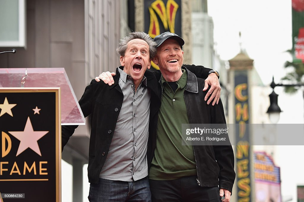 Producer Brian Grazer (L) stands with director Ron Howard as Howard is honored with a star on the Hollywood Walk of Fame on December 10, 2015 in Hollywood, California.