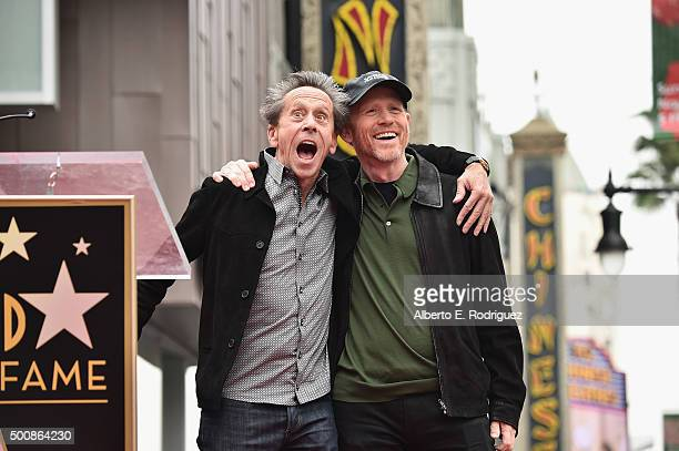 Producer Brian Grazer stands with director Ron Howard as Howard is honored with a star on the Hollywood Walk of Fame on December 10, 2015 in...