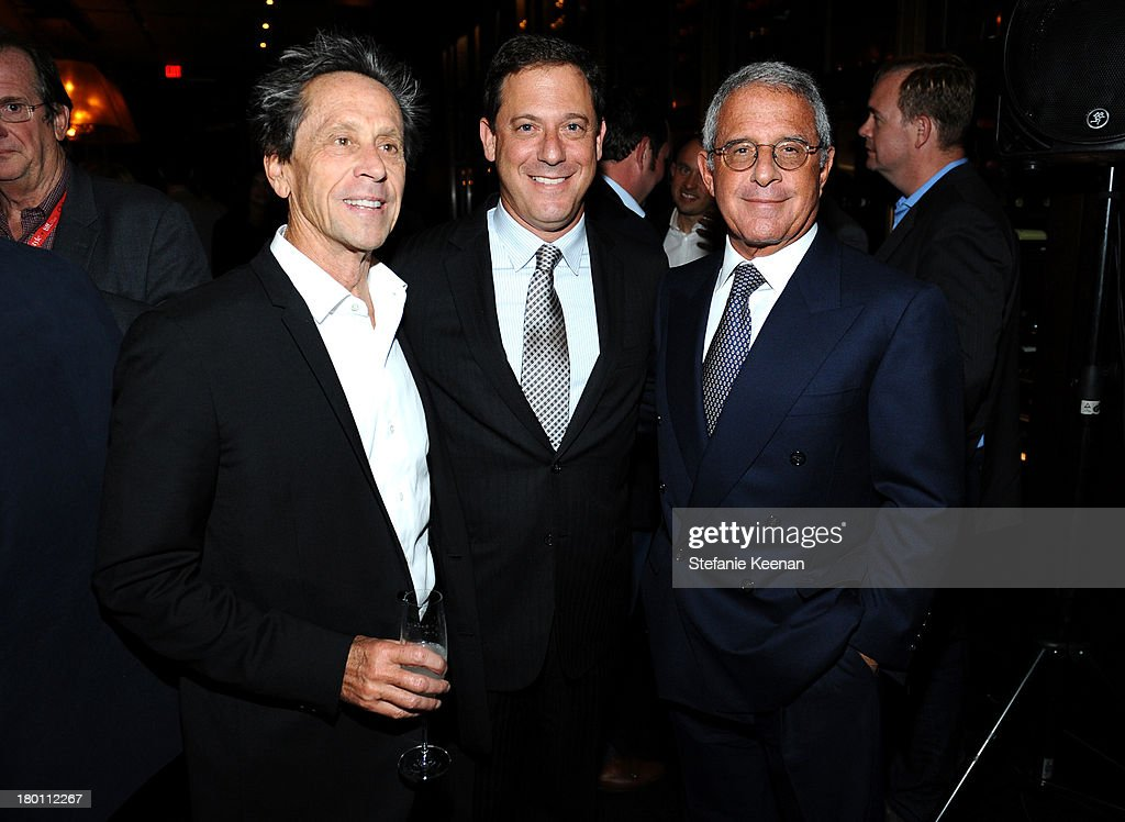 Producer Brian Grazer, Universal Pictures Chairman Adam Fogelson and head of Universal Ron Meyer at the Grey Goose vodka co-hosted party for 'Rush' on September 8, 2013 in Toronto, Canada.