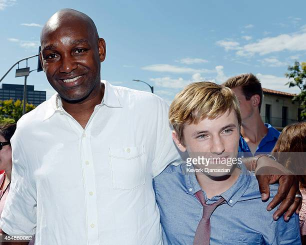 Producer Broderick Johnson and cast member Nathan Gamble pose during the film premiere of Warner Bros Pictures' and Alcon Entertainment's ''Dolphin...