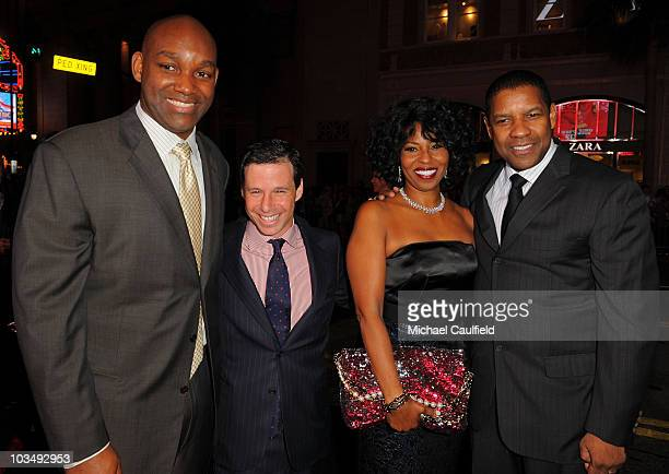 """Producer Broderick Johnson, producer Andrew A. Kosove, Pauletta Washington and actor Denzel Washington arrive at """"The Book Of Eli"""" premiere held at..."""