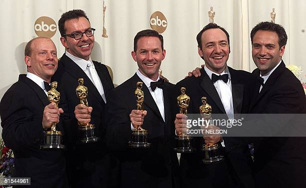 Producer Bruce Cohen screenwriter Alan Ball producer Dan Jinks actor Kevin Spacey and director Sam Mendes pose with their Oscars at the 2nd Academy...