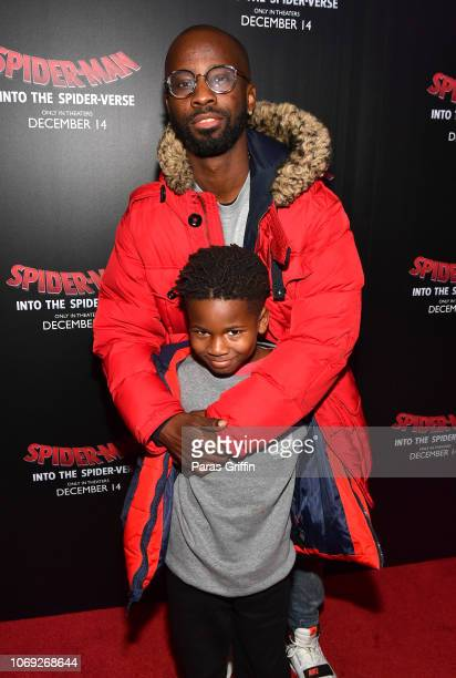 Producer BryanMichael Cox pose with his son during 'Spiderman Into The SpiderVerse' Atlanta screening at Regal Atlantic Station on December 6 2018 in...