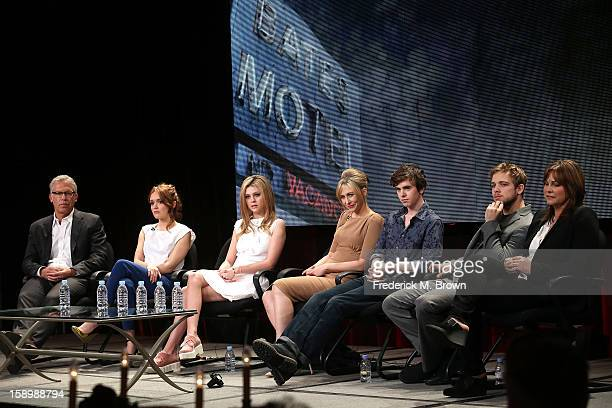 Producer Carlton Cuse actors Olivia Cooke Nicola Peltz Vera Farmiga Freddie Highmore Max Thieriot and Executive Producer Kerry Ehrin speak onstage...