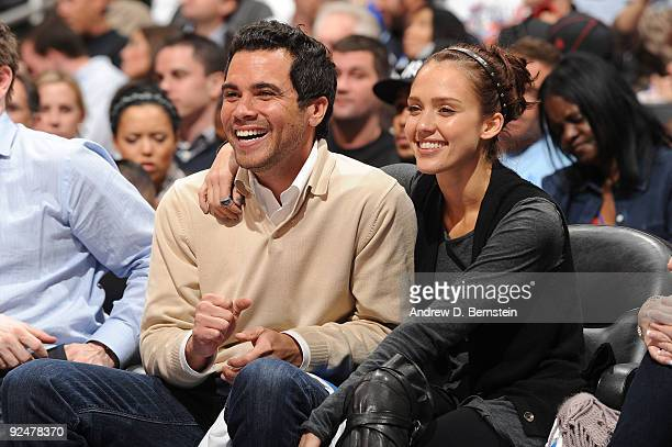 Producer Cash Warren and Actress Jessica Alba attend a game between the Phoenix Suns and the Los Angeles Clippers in the home opener at Staples...