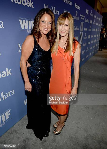 Producer Cathy Schulman and actress Holly Hunter attend Women In Film's 2013 Crystal Lucy Awards at The Beverly Hilton Hotel on June 12 2013 in...