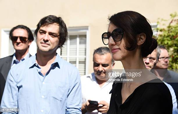 Producer Charles Gillibert and director Deniz Gamze Erguven attend the Champagne brunch reception honoring the French nominees for The 88th Academy...