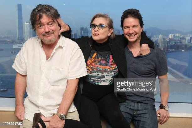 Producer Charles Wessler actress Carrie Fisher and John Penotti CEO president of Ivanhoe Pictures at Grand Hyatt hotel in Wan Chai 21NOV14