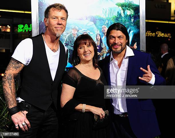 Producer Charlotte Huggins poses with Metallica band members James Hetfield and Robert Trujillo on arrival for the film premiere of 'Journey 2 The...