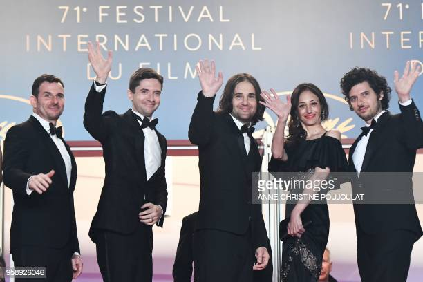 US producer Chris Bender US actor Topher Grace US director David Robert Mitchell and his wife Annie Mitchell and US music composer Rich Vreeland pose...