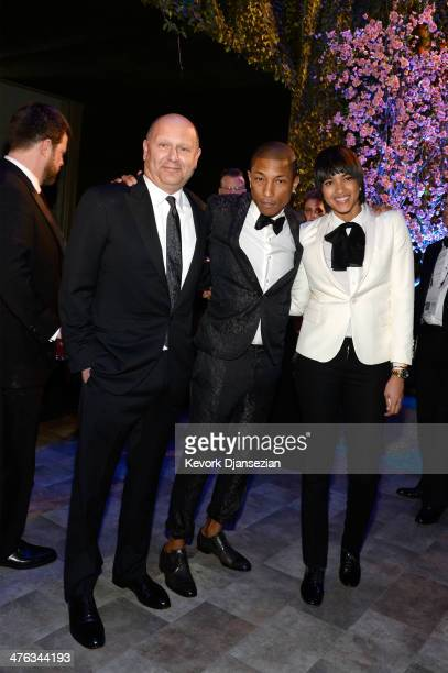 Producer Chris Meledandri Pharrell Williams and Helen Lasichanh attend the Oscars Governors Ball at Hollywood Highland Center on March 2 2014 in...